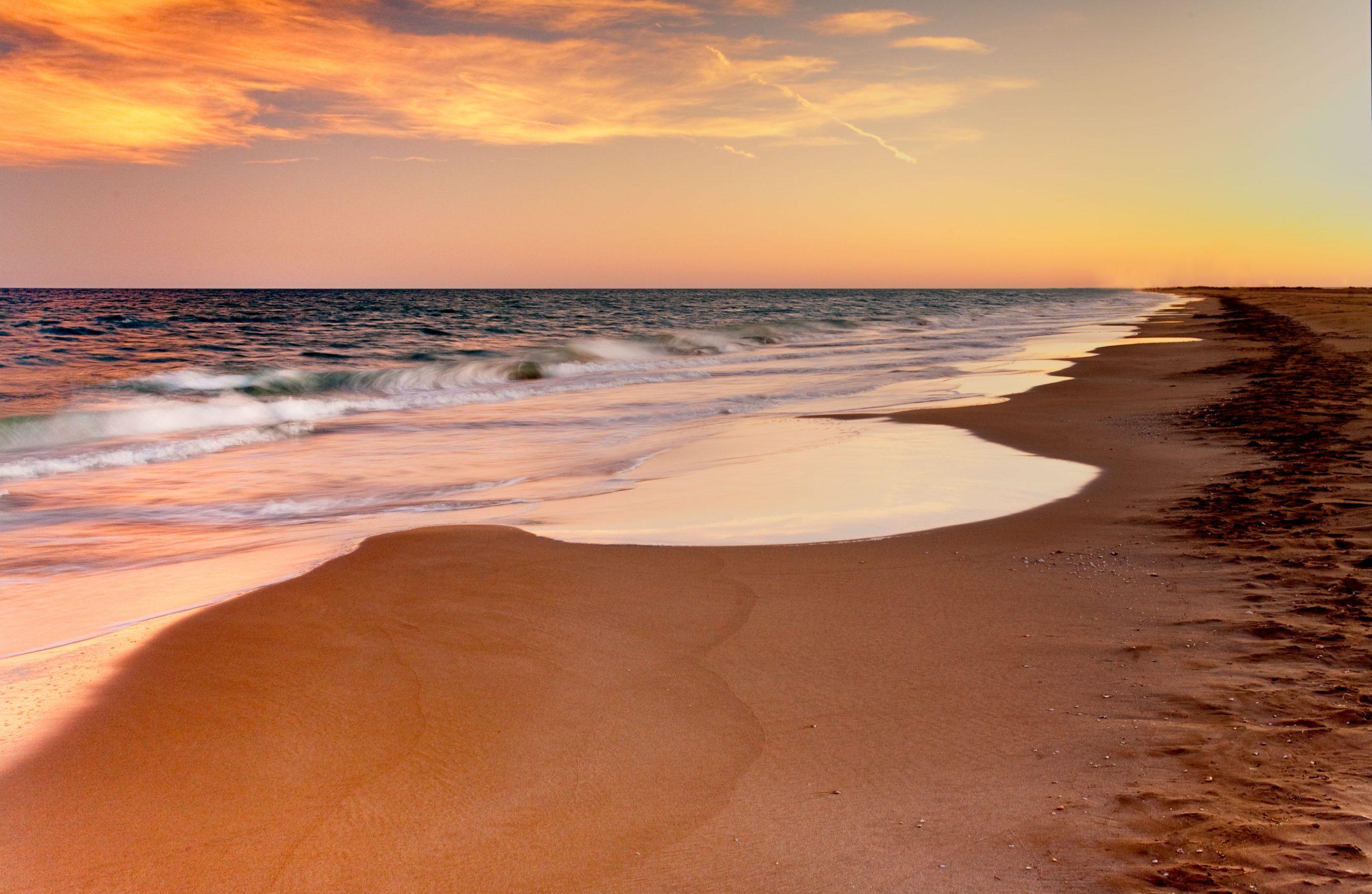 outdoor meeting Barcelona coastline beach sunset